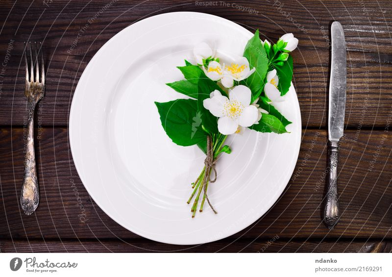 empty white round plate Dinner Plate Knives Fork Table Kitchen Restaurant Flower Bouquet Wood Natural Above White knife Top Vantage point background food Meal