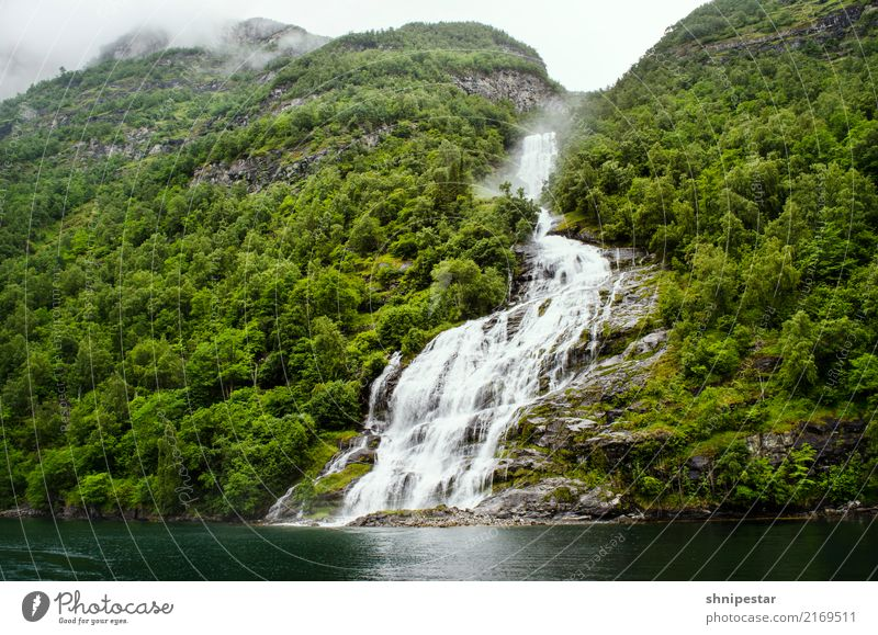 Waterfall Friaren in the Geirangerfjord, Norway Vacation & Travel Tourism Trip Cruise Expedition Mountain Hiking Environment Nature Landscape Clouds Bad weather