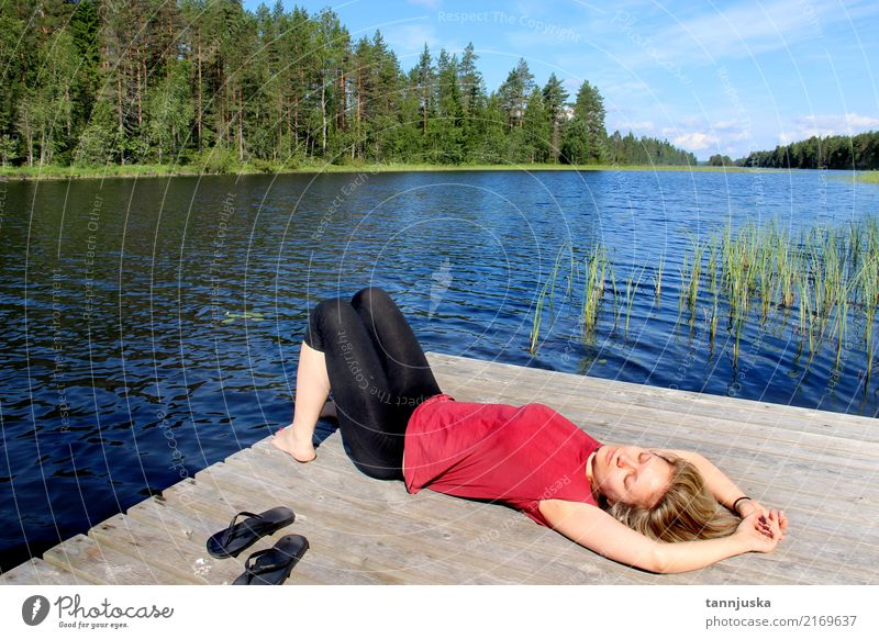 Young woman relaxing near lake in Karelia, Finland Lifestyle Beautiful Relaxation Vacation & Travel Tourism Camping Summer Woman Adults 1 Human being
