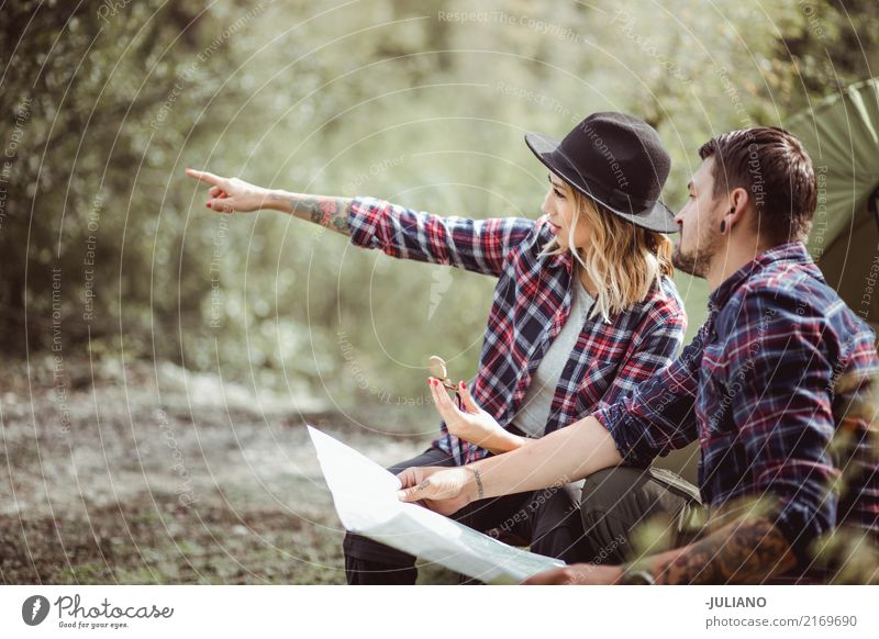 Camping Couple is searching for the way with map and compass Human being Woman Nature Vacation & Travel Youth (Young adults) Man Young woman Summer Young man