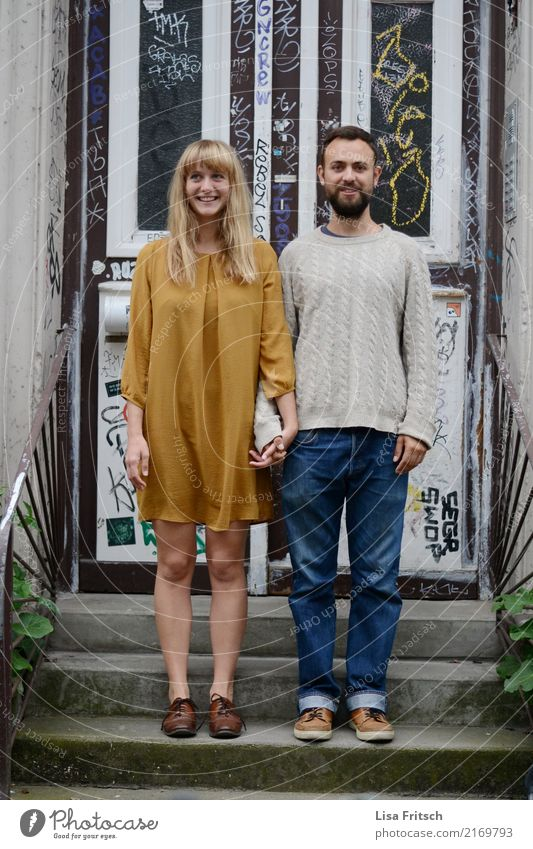 young couple - standing on stairs - hiphip Young woman Youth (Young adults) Young man Couple Partner 18 - 30 years Adults Stairs Front door Jeans Dress Sweater