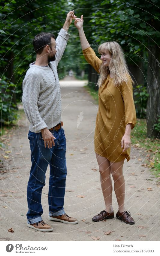 Turn around! Couple Partner 18 - 30 years Youth (Young adults) Adults Environment Nature Beautiful weather Tree Park Dress Long-haired To hold on To enjoy