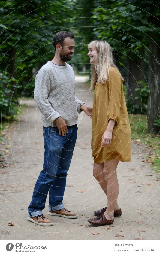 Young smiling couple on a path in the park. Couple Partner Life 2 Human being 18 - 30 years Youth (Young adults) Adults Environment Summer Park Jeans Dress