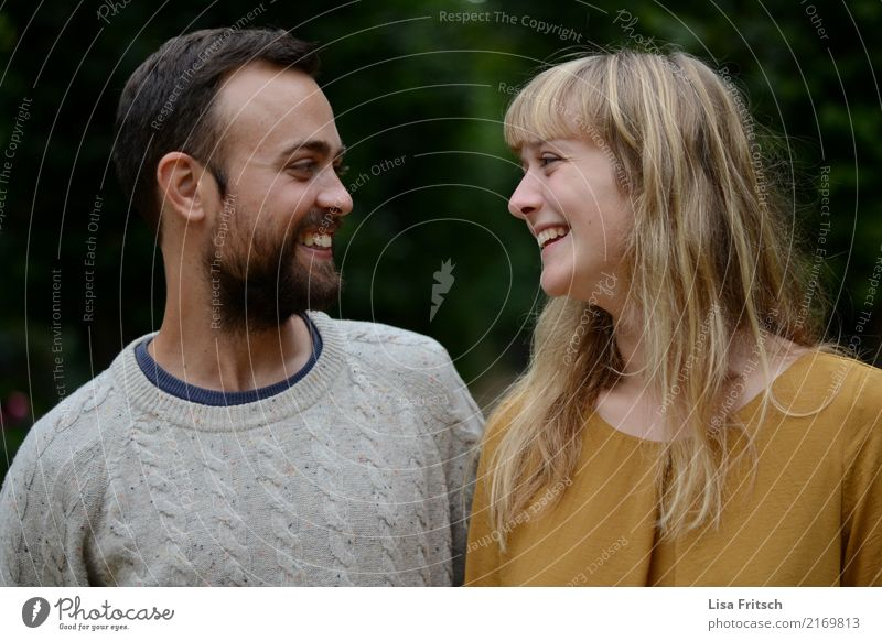 Young couple smiling at each other. Friendship Couple Partner Adults Life 18 - 30 years Youth (Young adults) Observe To enjoy Laughter Looking Friendliness