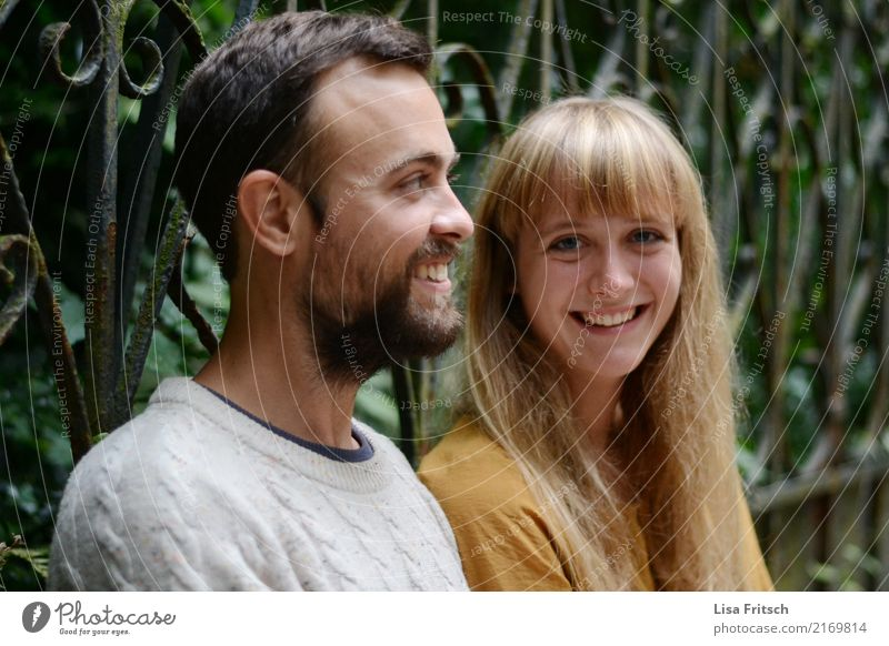 smiling young couple Friendship Couple Partner Adults 2 Human being 18 - 30 years Youth (Young adults) Environment Fence Long-haired Bangs Facial hair Observe
