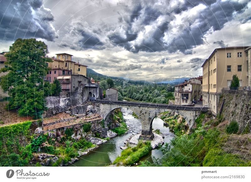 stone bridge of an ancient village under cloudy sky Vacation & Travel Tourism Mountain House (Residential Structure) Culture Nature Landscape Sky Weather Storm