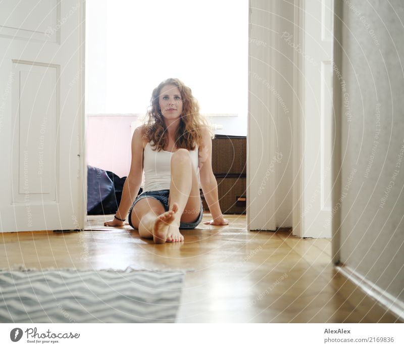 sits Style Joy Beautiful Body Well-being Flat (apartment) Room Parquet floor Hallway Period apartment Door Young woman Youth (Young adults) Face Legs