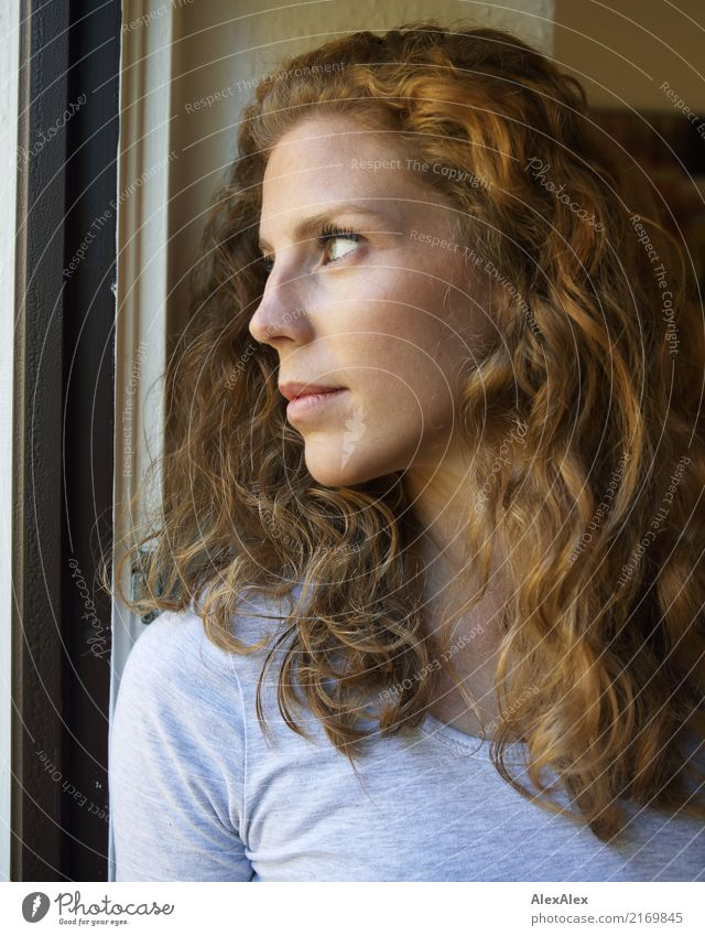 young, redheaded woman with curls looks out of the balcony window Style already Face Life Young woman Youth (Young adults) Hair and hairstyles 18 - 30 years