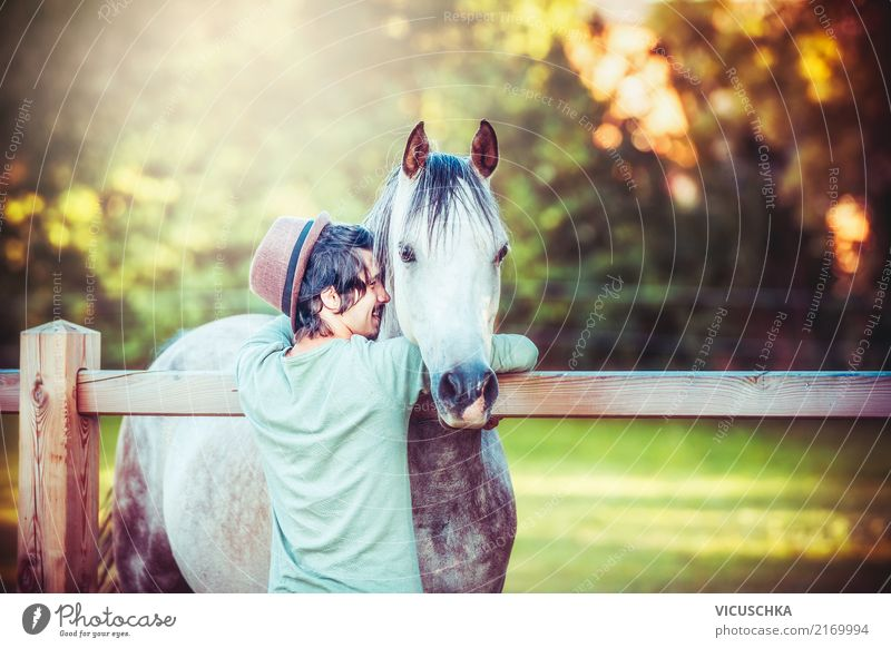 Young man hugging a horse Lifestyle Joy Leisure and hobbies Summer Winter Equestrian sports Human being Masculine Youth (Young adults) Nature Animal Horse Love