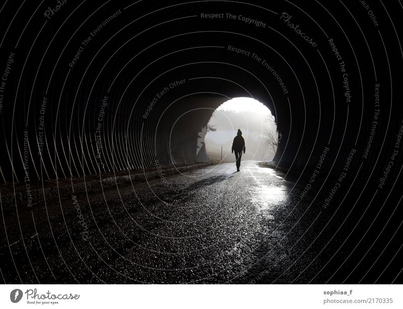 Light at the end of the tunnel, silhouette going through the darkness Tunnel Silhouette depression mental illness Lonely End Human being Fear never stop Hope