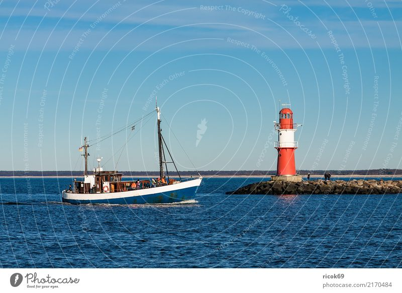 A fishing boat at the jetty of Warnemünde Relaxation Vacation & Travel Tourism Ocean Nature Landscape Water Clouds Rock Coast Baltic Sea Fishing boat Watercraft