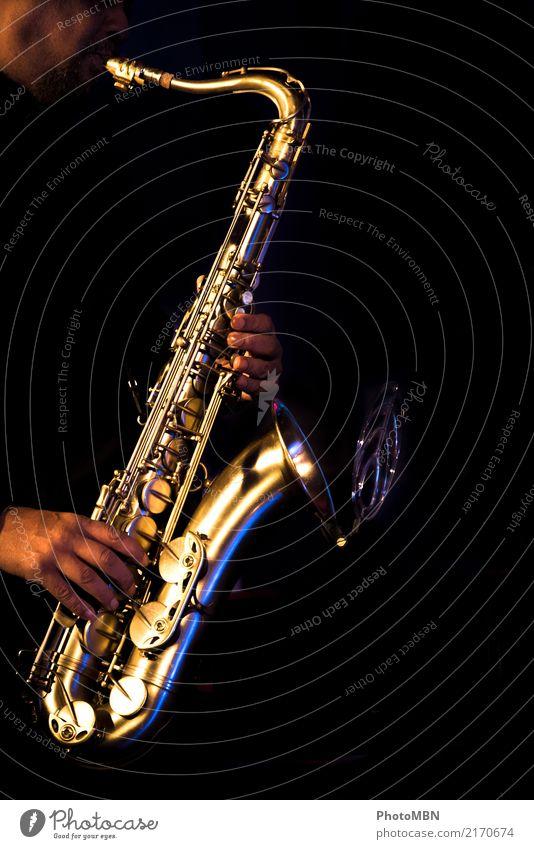 sax Lifestyle Design Musician Artist Entertainment electronics Musical instrument Masculine Hand 1 Human being 45 - 60 years Adults jazz concert Concert