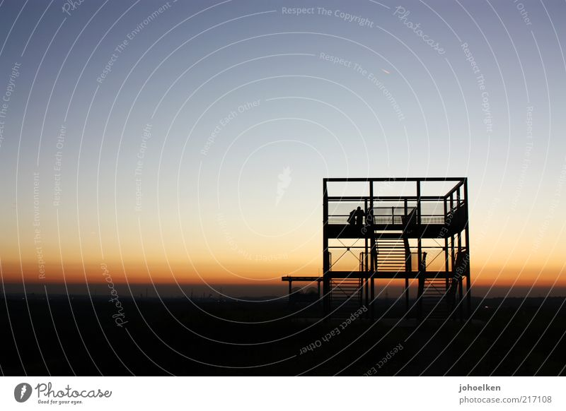Layer at shaft V Mine Mine tower Couple 2 Human being Culture Industrial heritage Cloudless sky Horizon Sunrise Sunset The Ruhr Monument Blue Yellow Gold Red