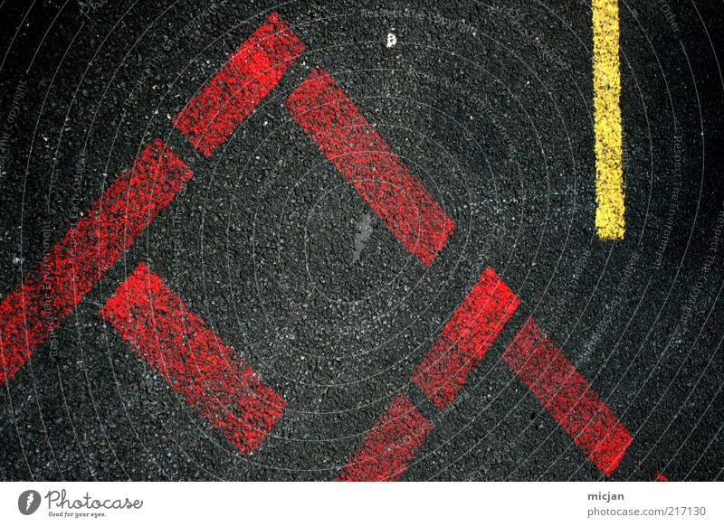 Red Black Yellow Street Line Signs and labeling Corner Characters Floor covering Asphalt Letters (alphabet) Stripe Sign Airport Parking lot
