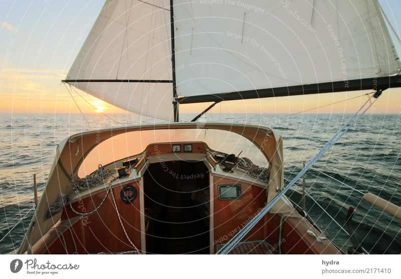 Sailing in calm seas before the wind into the sunrise sunset Sailboat Sailing ship Ocean Adventure Sun Waves Yachting Water Cloudless sky Sunrise Sunset
