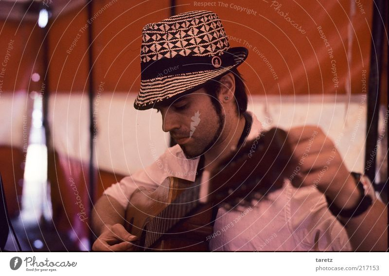 Preparation Human being Red Music Adults Masculine Concentrate Listening Hat Guitar Culture Expectation Musician Anxious Artist Circus Portrait photograph