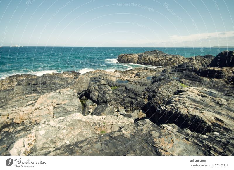 Nature Water Sky Ocean Far-off places Stone Landscape Coast Waves Environment Horizon Rock Climate Elements Beautiful weather England