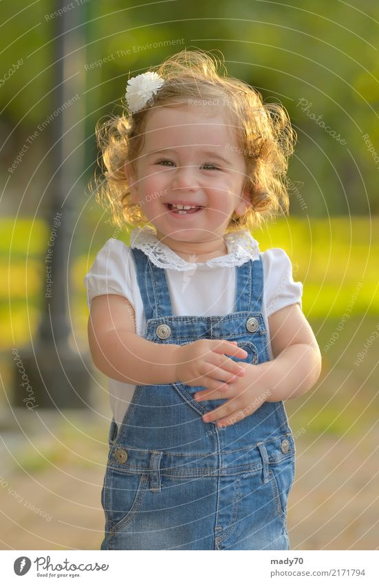 Little girl smiling against the sun Joy Happy Face Life Sun Child Toddler Woman Adults Infancy Park Smiling Happiness Small Natural Cute Innocent Girl Isolated