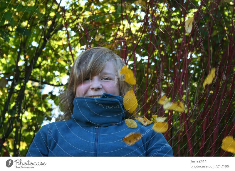 leaf rain Garden Autumn Bushes Leaf Sweater Blonde Bangs To enjoy Happiness Multicoloured Exterior shot Light Shadow Upper body Looking into the camera