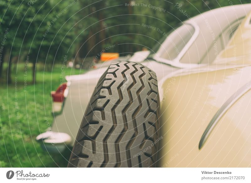 Spare car wheel of a vintage car Old White Black Sports Style Business Design Metal Transport Car Retro Historic Luxury Vehicle Conceptual design Ancient