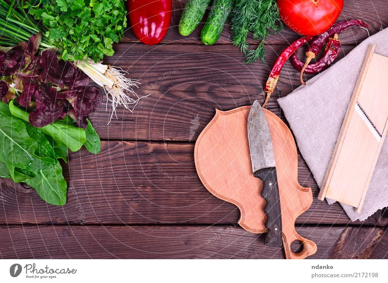 fresh vegetables and herbs for salad Vegetable Herbs and spices Knives Wood Fresh Natural Above Green Red Tomato pepper Parsley Salad food Useful Vitamin Onion