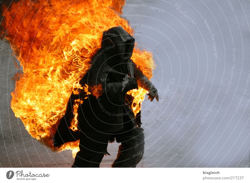 stuntman Stunt Human being 1 Protective clothing Walking Running Speed Yellow Gray Red Black Fear Horror Fear of death Threat Blaze Flame Colour photo