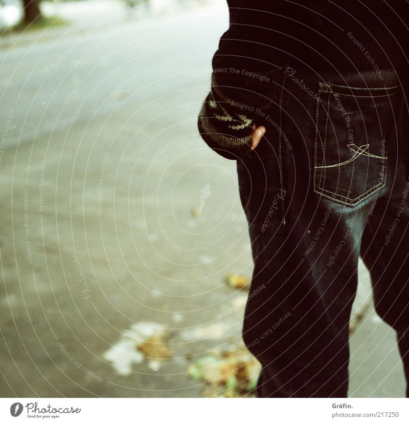 Human being Man Leaf Black Loneliness Street Cold Autumn Gray Legs Wait Adults Jeans Stand Asphalt Analog