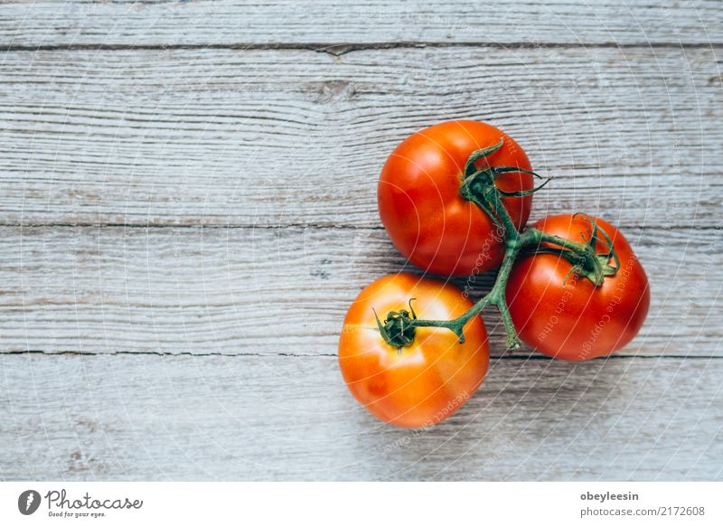 Close-up of fresh, ripe tomatoes on wood background Nature Plant Summer Green White Red Leaf Natural Wood Small Garden Group Growth Fresh Herbs and spices