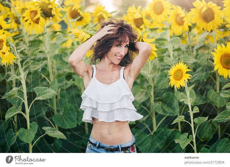 smiling girl in Sunflower Field Lifestyle Joy Wellness Contentment Human being Feminine Young woman Youth (Young adults) Woman Adults 1 30 - 45 years Plant