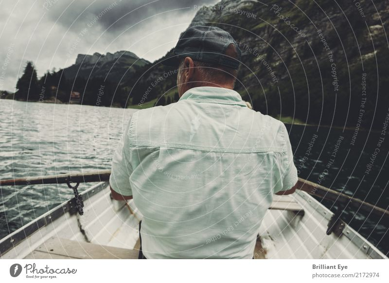 country in view Lifestyle Rowing Vacation & Travel Trip Rowboat Oar Human being Masculine Man Adults 45 - 60 years Nature Water Bad weather Gale Rock Alps Lake
