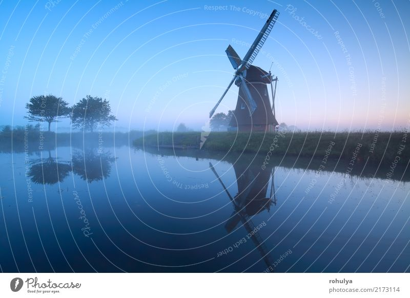 Dutch windmill by lake in dusk, Holland Nature Landscape Sky Sunrise Sunset Summer Tree Pond Lake Village Building Architecture Old Blue Serene Symmetry