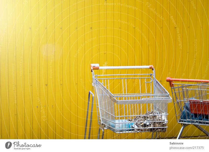 Schoppin Shopping Trade Shopping Trolley Metal Plastic Yellow Red Silver Consumption Trash Grating Door handle Economic crisis Colour photo Multicoloured