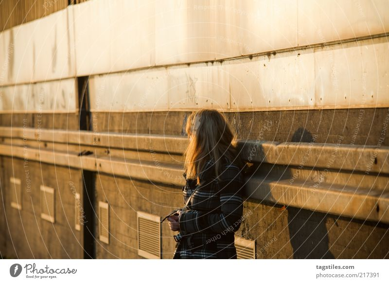Woman Calm Loneliness Yellow Wall (building) Dream Sadness Think Warmth Orange Change Natural Meditative Thought Coat Long-haired