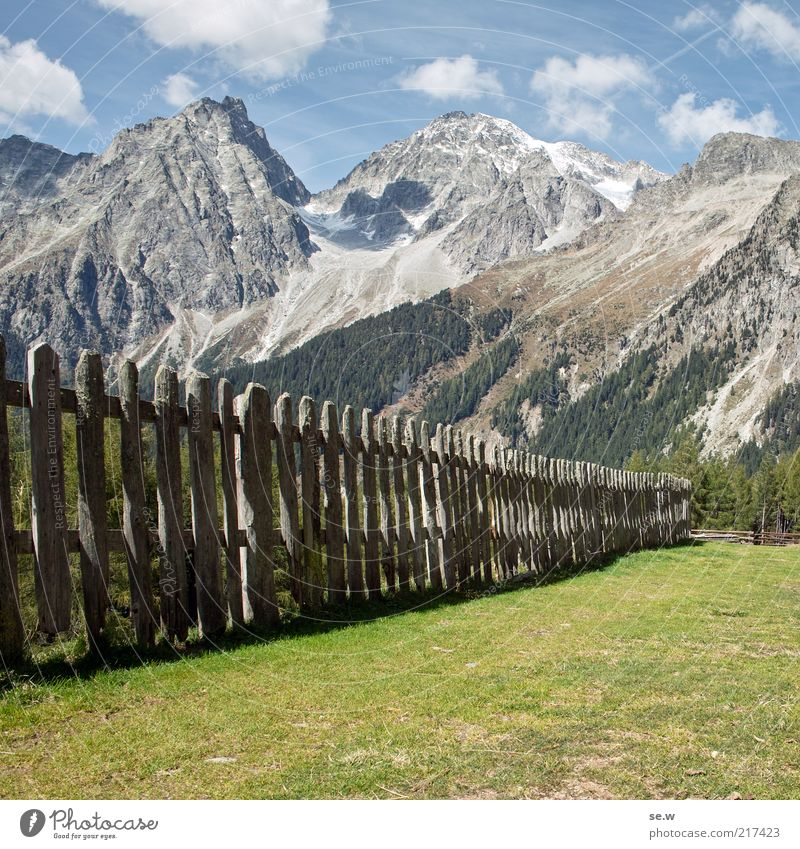 Sky Green Summer Vacation & Travel Calm Clouds Meadow Mountain Lanes & trails Landscape Environment Alps Historic Fence Beautiful weather Alpine pasture
