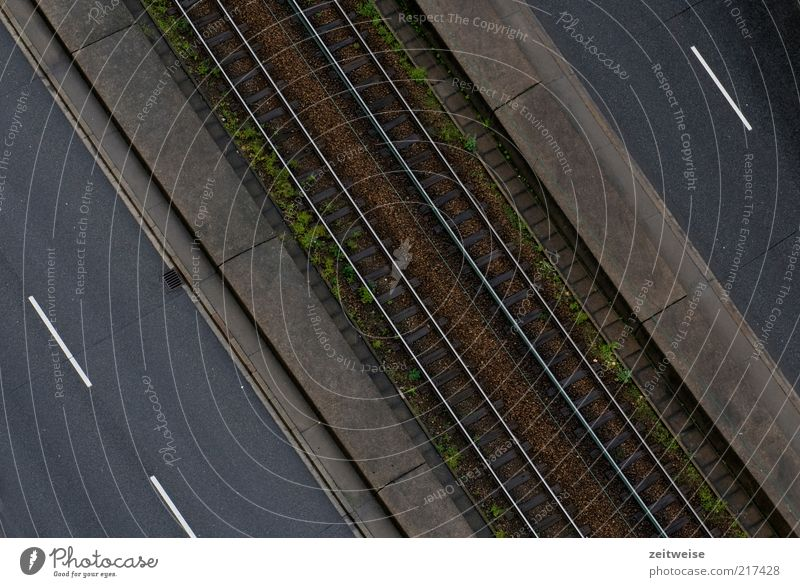off Deserted Traffic infrastructure Public transit Road traffic Street Brown Gray Pavement Railroad tracks Railroad system Median strip Colour photo