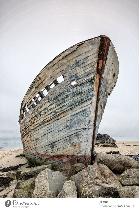 From the time Horizon Rock Fishing boat Wood Old Tall Maritime Blue Brown Loneliness Idyll Death Destruction Wreck Decompose Colour photo Subdued colour