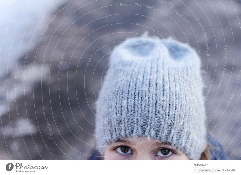 little spy Human being Girl 1 8 - 13 years Child Infancy Looking Observe Eyes Cap Winter Looking into the camera Hide Woolen hat Cold Spy Informer Exterior shot