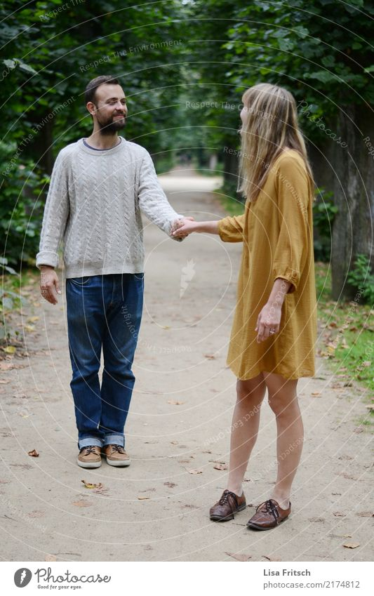 Holding hands - young couple Couple Partner Adults Life 2 Human being 18 - 30 years Youth (Young adults) tree Park Dress Facial hair Touch Communicate smile