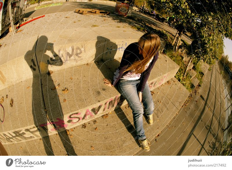 Human being Youth (Young adults) Sun Feminine Graffiti Together Sit Stairs Perspective Jeans Brunette To enjoy Hang River bank Attachment