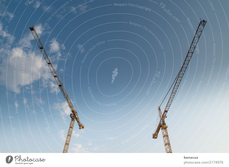 radio silence Sky Blue Discordant Animosity Construction crane Crane Construction site Opposite Looking away Symmetry crane technology Colour photo