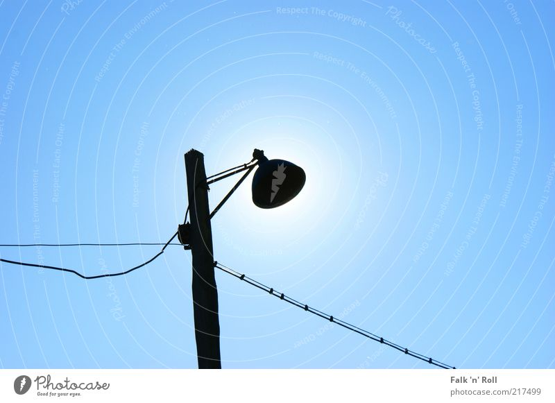 Eclipse of the Sun Sky Solar eclipse Sunlight Summer Beautiful weather Lamp post Old Street lighting Silhouette Blue Black Cable Simple Deserted Colour photo