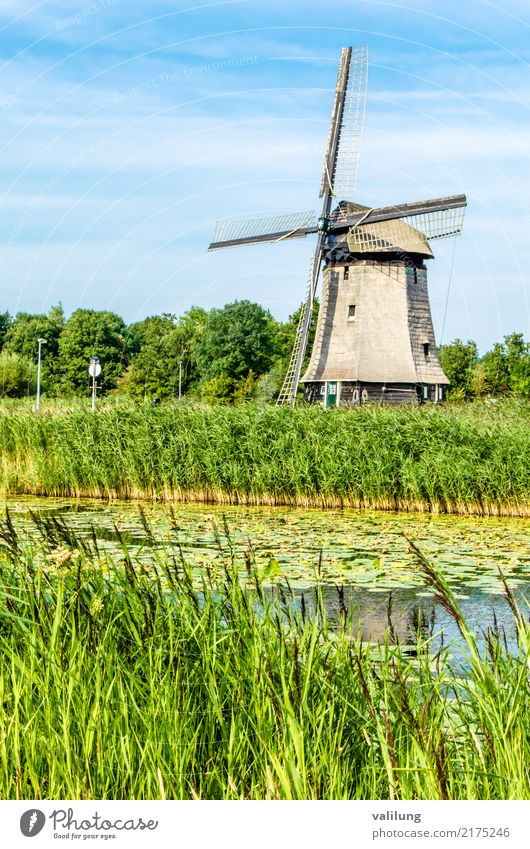 Traditional Dutch windmill Vacation & Travel Tourism Landscape Park River Building Architecture Green Alkmaar Europe Netherlands canal colorful field Mill water