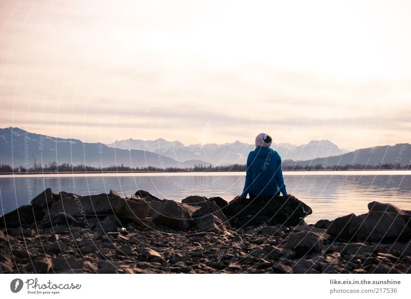 Human being Blue Winter Loneliness Calm Far-off places Relaxation Landscape Mountain Freedom Stone Lake Horizon Contentment Rock Sit