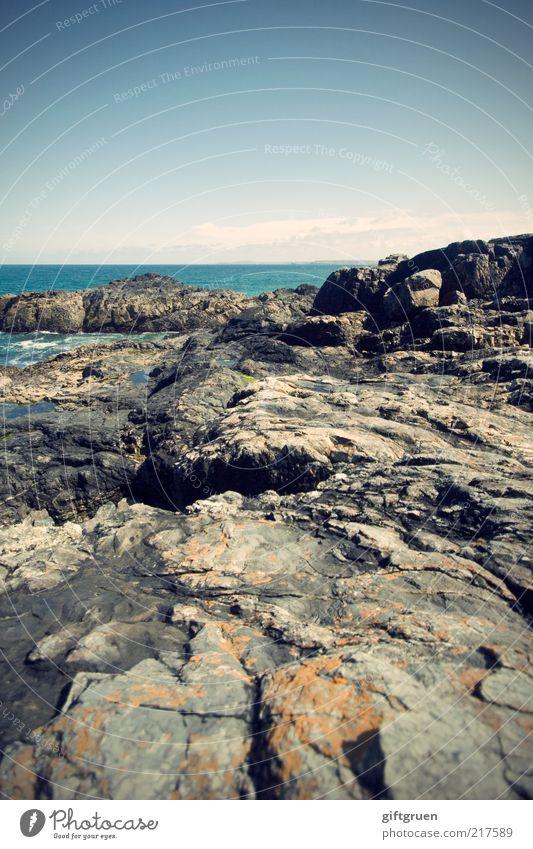 Nature Water Sky Ocean Blue Beach Far-off places Gray Stone Landscape Coast Environment Horizon Rock Esthetic Island