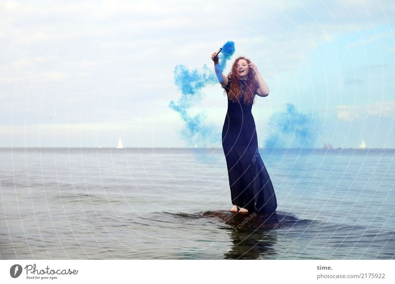 nina Feminine Woman Adults 1 Human being Water Sky Clouds Horizon Coast Baltic Sea Dress Red-haired Long-haired Torch Stone To hold on Laughter Stand