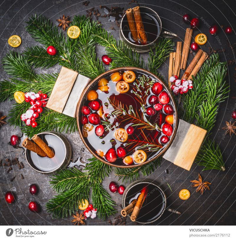 Mulled wine in a pot with cups and ingredients Food Herbs and spices Beverage Hot drink Alcoholic drinks Wine Pot Cup Style Design Winter Living or residing