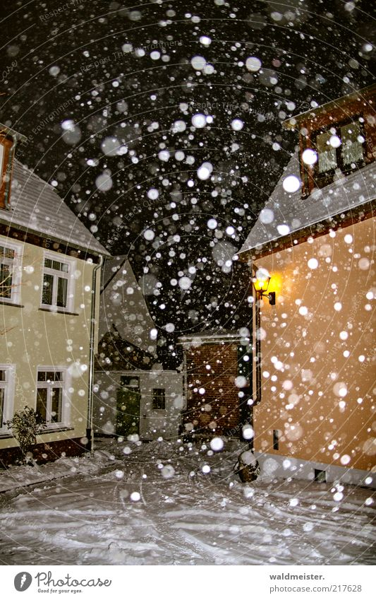 winter Weather Snow Snowfall Small Town Cold Brown Yellow Loneliness Calm Snowflake Winter Colour photo Multicoloured Exterior shot Experimental Abstract Night