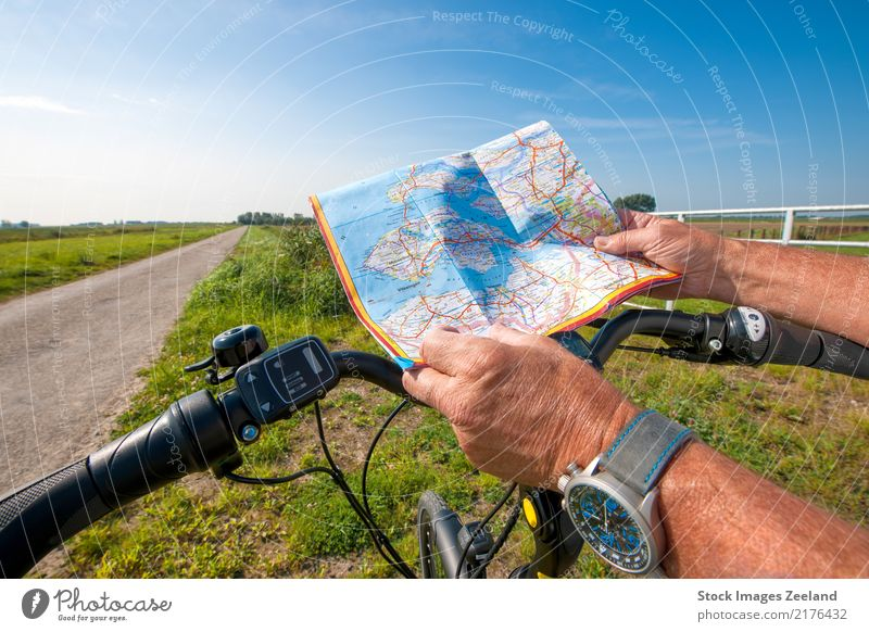 man with an e-bike looks at a road map Human being Sky Nature Vacation & Travel Summer Sun Hand Landscape Adults Street Lifestyle Healthy Sports Tourism Freedom