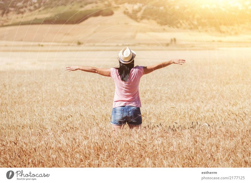 Happy girl in the wheat field Lifestyle Joy Wellness Harmonious Contentment Vacation & Travel Adventure Freedom Human being Feminine Young woman