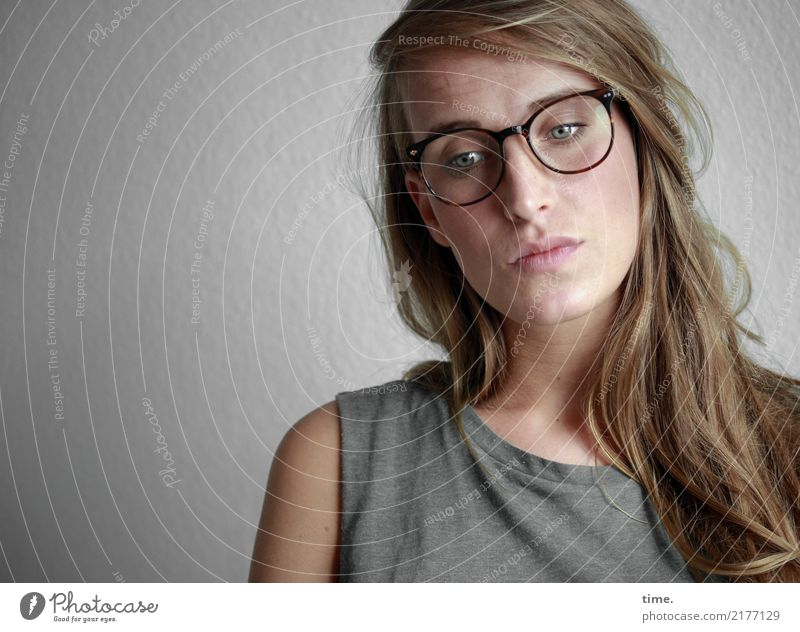 . Feminine Woman Adults 1 Human being T-shirt Eyeglasses Blonde Long-haired Observe Think Looking Wait Beautiful Self Control Sadness Concern Fatigue Longing
